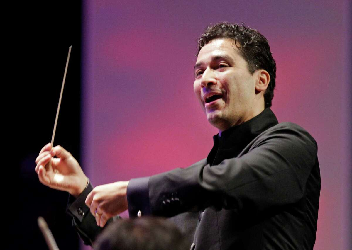 The Houston Symphony with music director Andres Orozco-Estrada is shown during performance at Miller Outdoor Theatre Friday, Sept. 12, 2014, in Houston.
