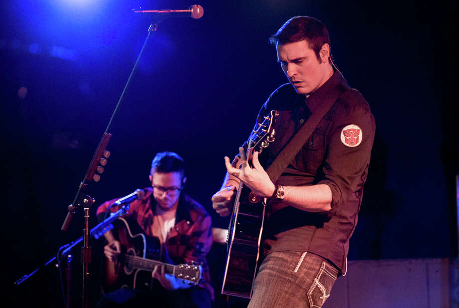 Breaking Benjamin frontman Benjamin Burnley, right, and guitarist Keith Wallen perform during the band's sold-out show Thursday, Oct. 16, 2014, at Upstate Concert Hall in Clifton Park, N.Y. (Photo: Trudi Shaffer / Times Union) Photo: Trudi Hargis / Trudi Hargis Photography