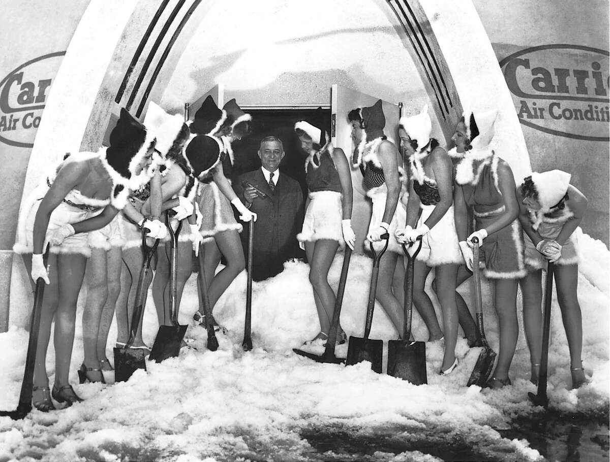 """Willis Haviland Carrier, center, at his company's """"Igloo of Tomorrow"""" exhibit in 1939."""