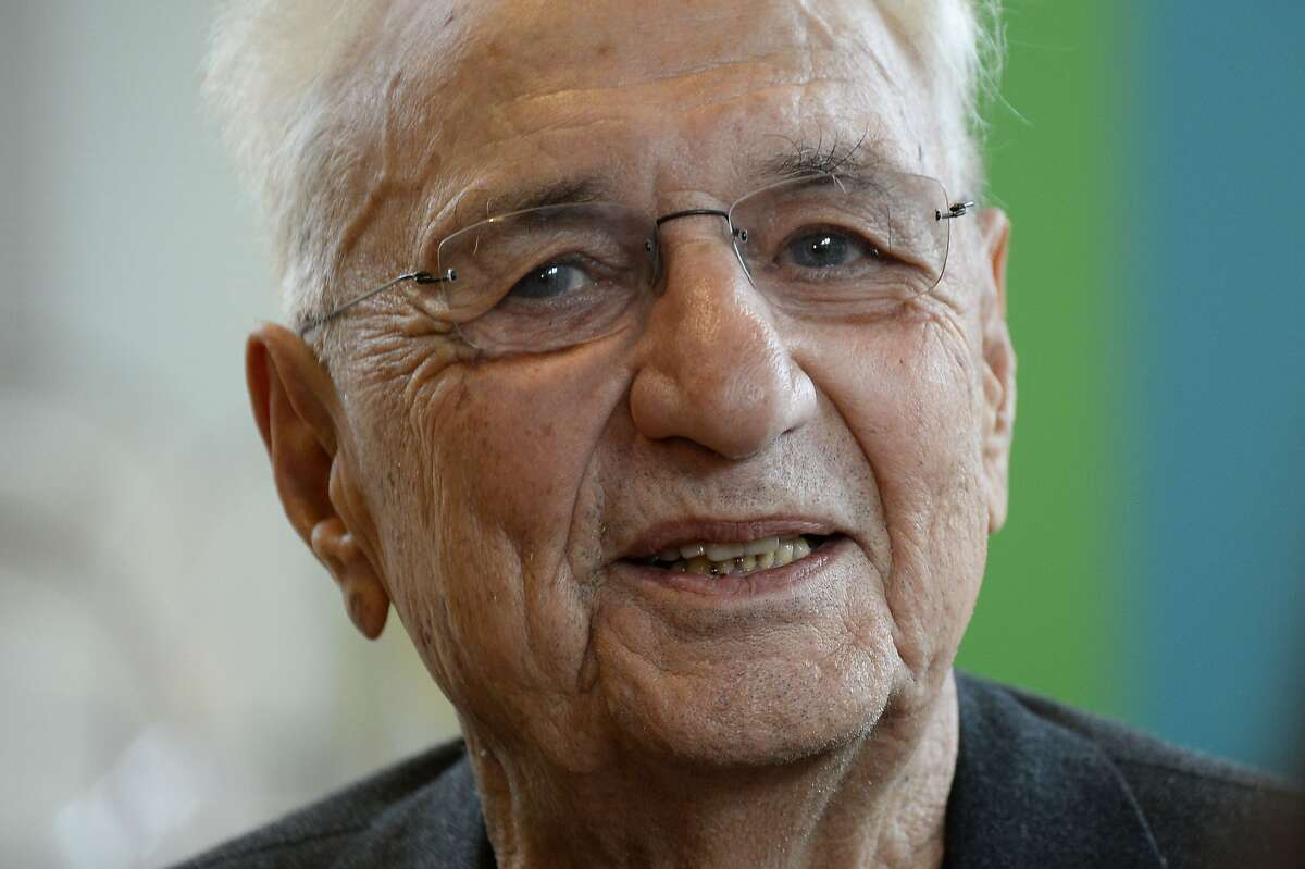 Canadian-American architect Frank Gehry poses at the Louis Vuitton Fondation in the Bois de Boulogne in Paris on October 17, 2014. The building which takes the form of a sailboat amongst the trees of the Bois de Boulogne, consists of twelve huge sails glass, and is part of the long tradition of architectural glass such as the Grand Palace. AFP PHOTO / BERTRAND GUAYBERTRAND GUAY/AFP/Getty Images