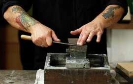 Cutler Josh Donald sharpens knives at Bernal Cutlery in S.F.