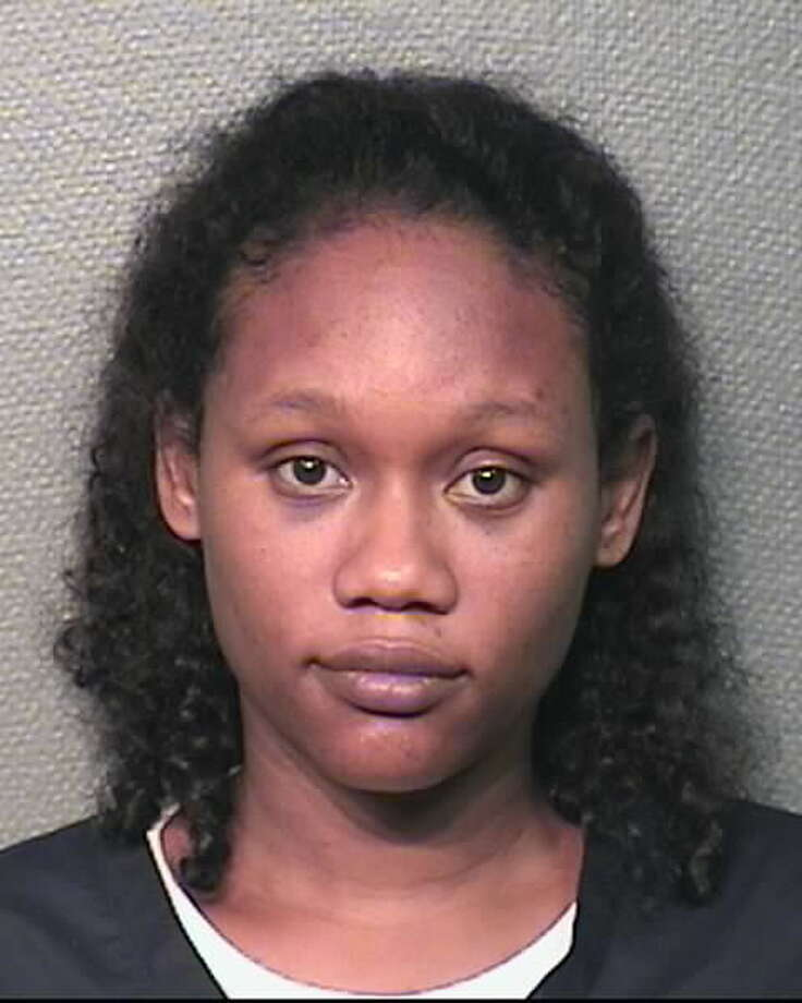 Tiffany Marie Wilson, 33, of Houston, is charged with endangering a child. She allegedly left her 2-year-old son outside at night, strapped in his stroller. (HPD)