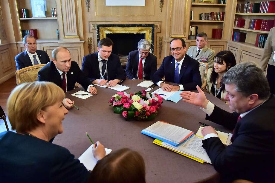 German Chancellor Angela Merkel (bottom right), Russia's President Vladimir Putin (left), French President Francois Hollande (third from right) and Ukraine's President Petro Poroshenko (right) attend a meeting on October 17, 2014 in Milan during the 10th Asia-Europe Meeting (ASEM). Photo: Giuseppe Cacace, AFP/Getty Images
