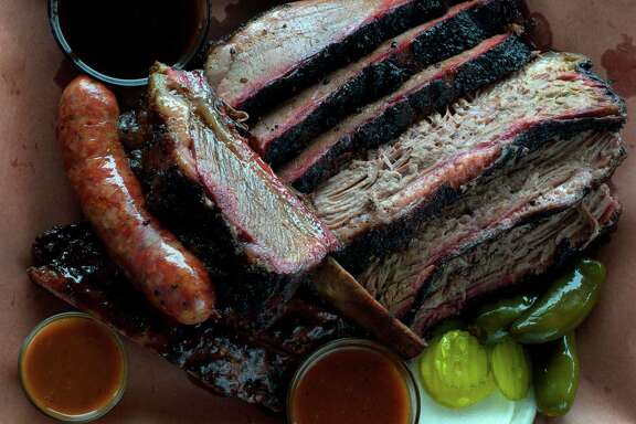Brisket, sausage and beef ribs as served at Killen's Barbecue in Pearland. Shot April 2014.