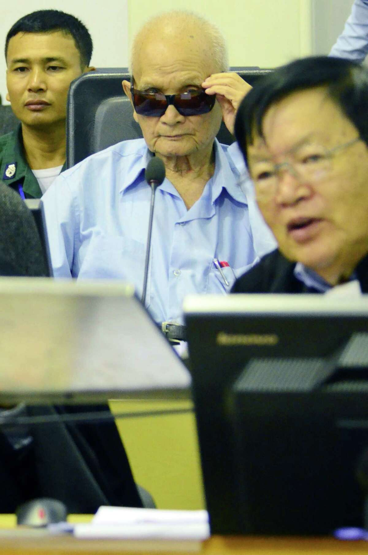 """Former Khmer Rouge leader """"Brother Number Two"""" Nuon Chea (center) sits in a Phnom Penh courtroom."""