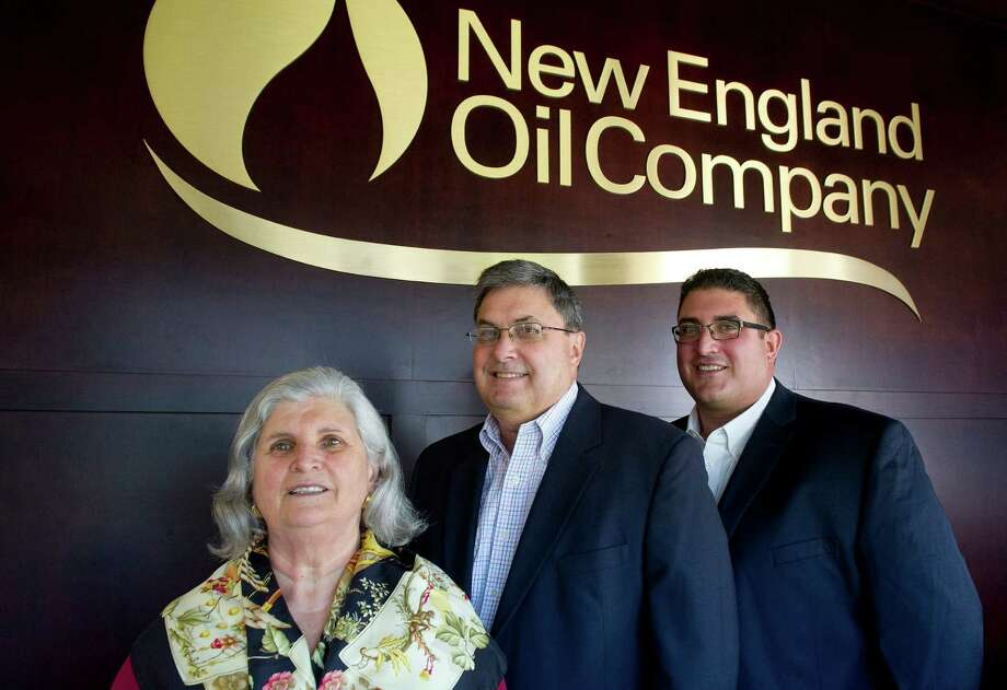From left, President Yolanda Cortese, Vice President Gary Lisiewski, and Operations Manager Frank Cortese pose for a photo in New England Oil Company's office in Greenwich, Conn., on Friday, October 17, 2014. The family-run business is celebrating its 75th anniversary. Photo: Lindsay Perry / Stamford Advocate