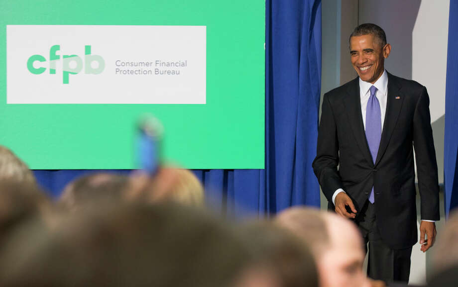 President Obama prepares to deliver remarks at the Consumer Financial Protection Bureau, where he said more must be done to stop data breaches. Photo: Evan Vucci / Associated Press / AP