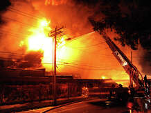 A massive fire erupted at an industrial site along Seaview Avenue in Bridgeport, Conn., on Thursday Sept. 11, 2014. Fire cews from Fairfield and Stratford responded with equipment and manpower to help battle the blaze.