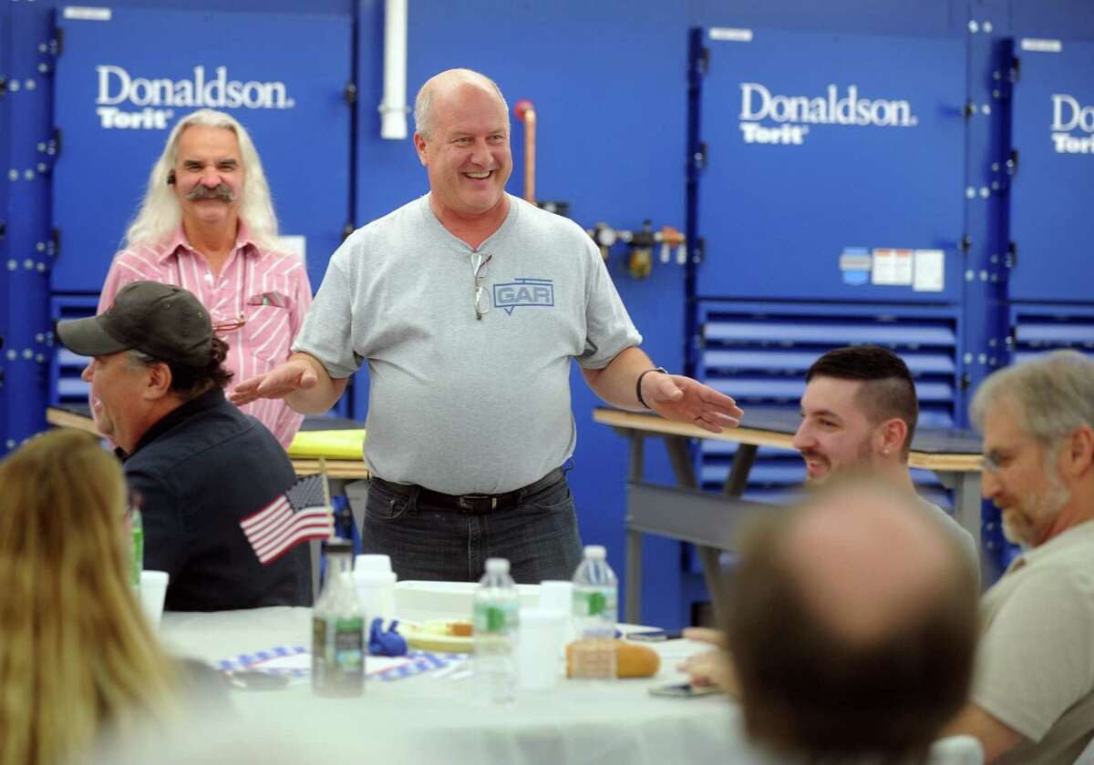 President and CEO Russell Richter talks to employees Friday, Oct. 17, 2014, at GAR Electroforming's new facility on Eagle Road in Danbury. This is the company's third location in the city.