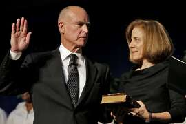 Governor-elect Jerry Brown with his wife Anne Gust Brown by his side is sworn in at Governor of California by Chief Justice Tani Cantil-Sakauye, Monday January 3, 2011, at the Memorial Auditorium in Sacramento, Calif.