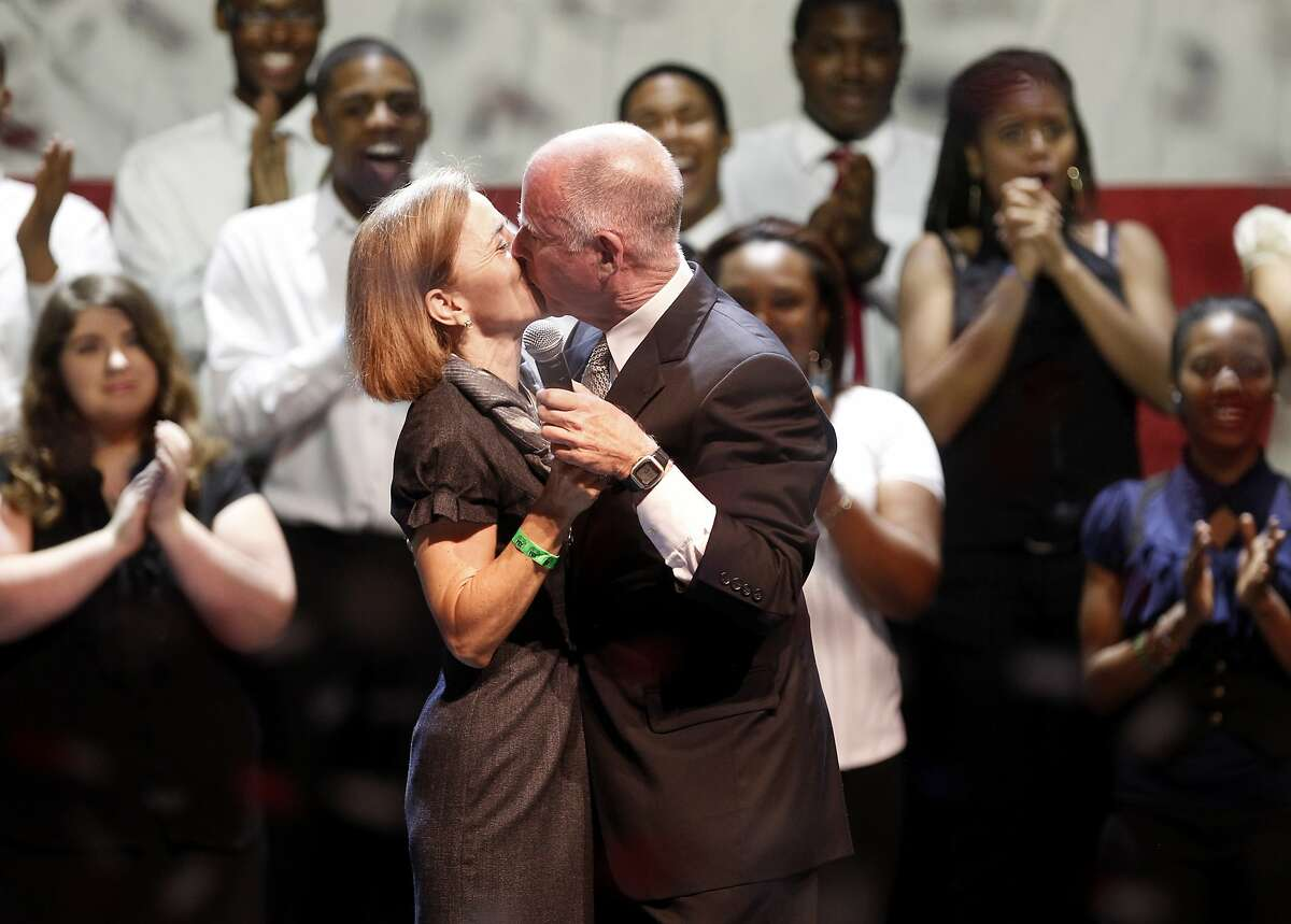 Jerry Brown kissed his wife Anne Gust after thanking her for all her help during the campaign. Members of the Oakland School for the Arts in background. Governor-elect Jerry Brown addressed supporters at the Fox Theatre in downtown Oakland, Calif. Tuesday November 2, 2010.