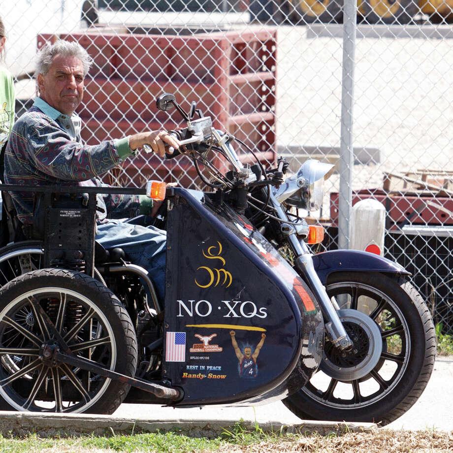 Dave Gaston on his custom, three-wheel Harley Davidson. Photo: Al Ruscelli