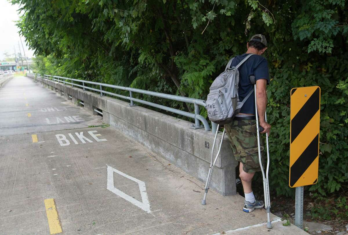 He's back home. After a summer of sobriety and a trailer filled with amenities, Paul Carbonneau starts drinking again and has to return to his camp under the Galleria-area bridge. It's a bittersweet moment for him and all those who tried to help him. ( Johnny Hanson / Houston Chronicle )