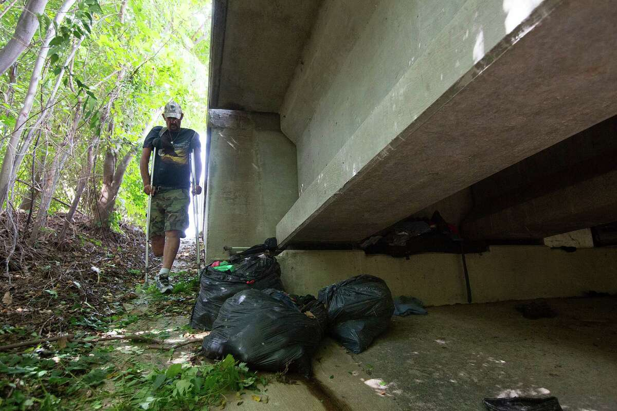 After four months in a trailer with air conditioning, bathroom facilities and a refrigerator, Paul Carbonneau returns to his home under the Galleria-area bridge. He's lived there for 14 years, and it is home.