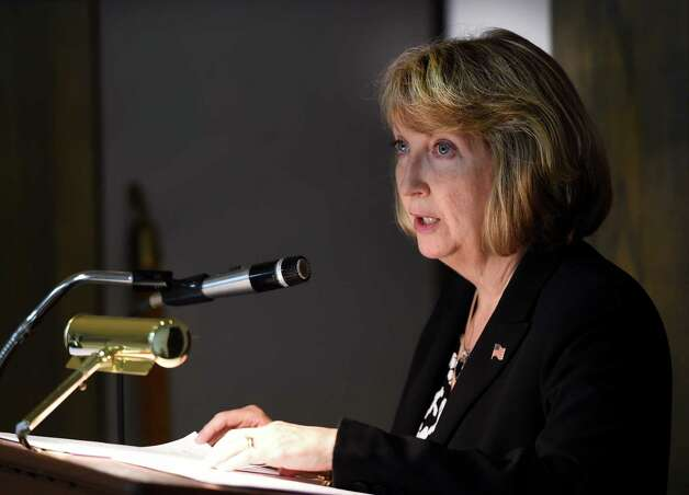 Rensselaer County Executive Kathy Jimino presents the proposed 2015 Rensselaer County budget Friday morning, Oct. 17, 2014, at the Rensselaer County Legislative Chambers in Troy, N.Y. (Skip Dickstein/Times Union) Photo: SKIP DICKSTEIN / 10028931A