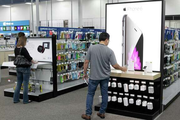 The iPhone 6 and 6 Plus and smartphone accessories are predicted to be big sellers during the upcoming holiday season. Here, a customer checks one out Friday at the Best Buy, 9670 Katy Freeway, in Houston. ( Melissa Phillip / Houston Chronicle )