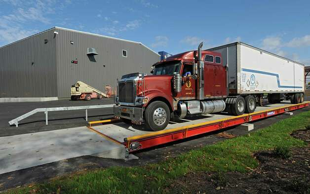 A truck gets weighed on a large scale outside the operations building at TCI of New York on Friday, Oct. 17, 2014 in Coeymans, N.Y. The electronics recycling company recently rebuilt and opened their new headquarters at Port of Coeymans. (Lori Van Buren / Times Union) Photo: Lori Van Buren / 10029071A
