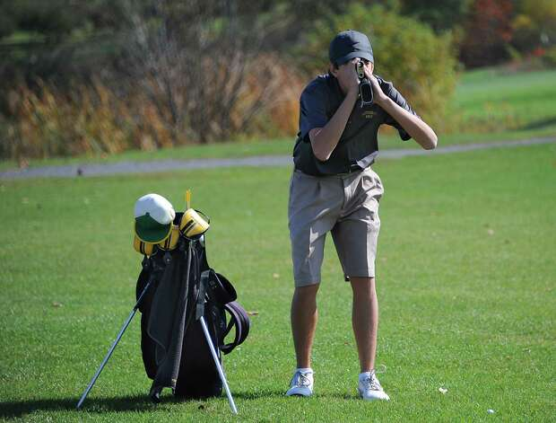 Amsterdam's James Phelps uses a rangefinder before he hits a fairway shot during the Section II state golf qualifier at Orchard Creek Golf Club on Friday, Oct. 17, 2014, in Altamont, N.Y.(Lori Van Buren / Times Union) Photo: Lori Van Buren / 00029052A