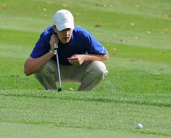 Saratoga's Chris Thompson studies his next putt during the Section II state golf qualifier at Orchard Creek Golf Club on Friday, Oct. 17, 2014 in Altamont, N.Y.(Lori Van Buren / Times Union) Photo: Lori Van Buren / 00029052A