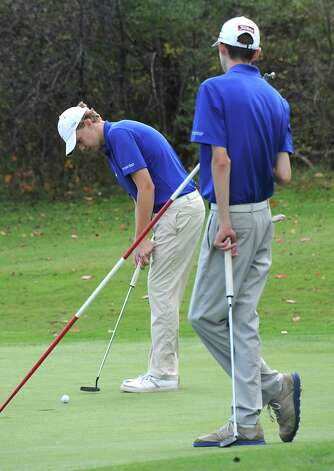 Saratoga's Chris Thompson putts during the Section II state golf qualifier at Orchard Creek Golf Club on Friday, Oct. 17, 2014 in Altamont, N.Y.(Lori Van Buren / Times Union) Photo: Lori Van Buren / 00029052A