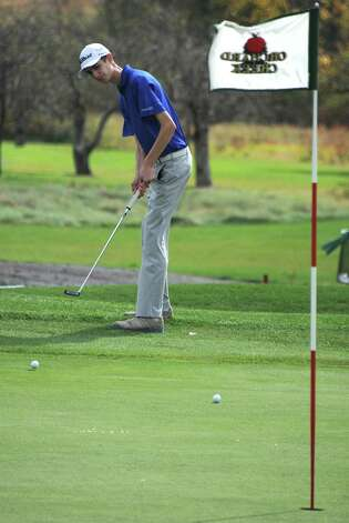 Saratoga's Andrew Losey putts onto the green during the Section II state golf qualifier at Orchard Creek Golf Club on Friday, Oct. 17, 2014 in Altamont, N.Y.(Lori Van Buren / Times Union) Photo: Lori Van Buren / 00029052A