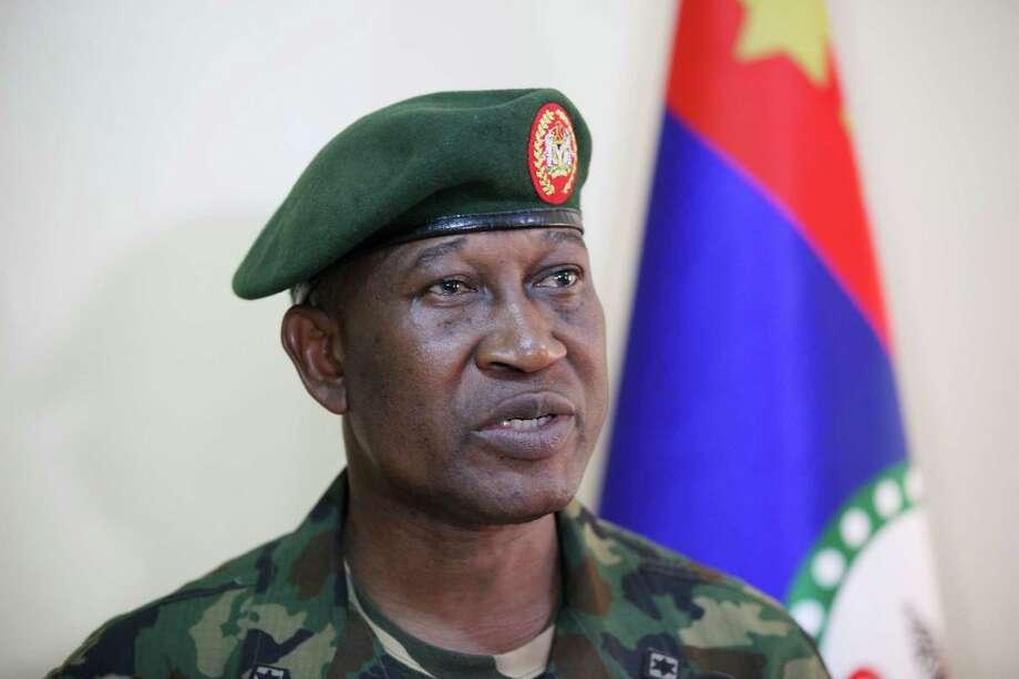 Maj. Gen. Chris Olukolade, Nigeria's top military spokesman, says the fate of more than 200 missing schoolgirls is still being negotiated. Photo: Jon Gambrell, STF / AP