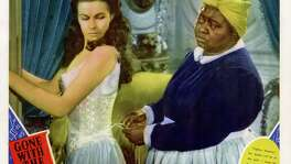 """""""Gone With the Wind"""" became an instant best-seller when published. It gained more fans - and enemies - when it was made into an epic film starring Vivien Leigh, left, and Hattie McDaniel."""