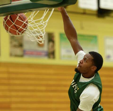 Siena Men's Basketball team Maurice White dunks during media day Friday morning, Oct. 17, 2014, at Siena College in Loudonville, N.Y. (Skip Dickstein/Times Union) Photo: SKIP DICKSTEIN / 10029024A