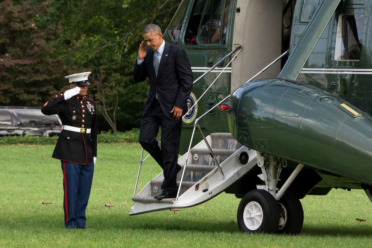 After meeting with military chiefs at Andrews Air Force Base, President Obama salutes a Marine as he exits the Marine One helicopter on the South Lawn of the White House. Readers criticize Obama for his policies.