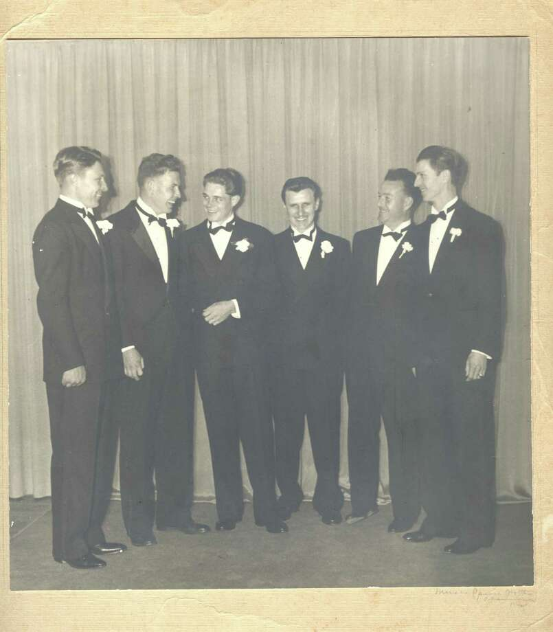 William Parker Cook, third from left with arm across waist, standing next to brother Roger Cook, third from right, and friends. Photo: Courtesy Bruce Cook / ONLINE_YES