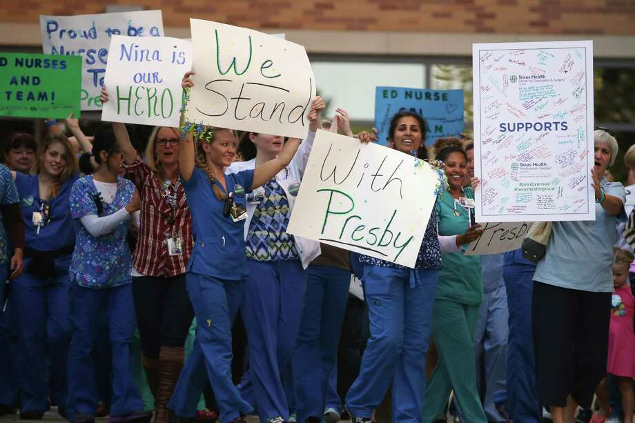 DALLAS, TX - OCTOBER 17: Nurses from Texas Health Presbyterian Hospital rally in support of their employer outside the hosptial October 17, 2014 in Dallas, Texas. Two of the hospital's nurses also contracted the virus while treating Thomas Eric Duncan, the Liberian who was the first patient diagnosed with Ebola in the United States. The hospital hired Burson-Marsteller, the global public relations firm, one week ago to help combat criticism that it mishandled the first case of Ebola in the United States. Photo: Chip Somodevilla, Getty Images / 2014 Getty Images