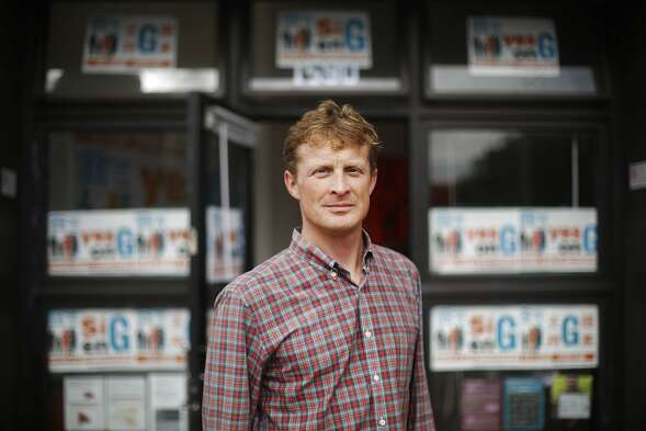Quintin Mecke, campaign manager Yes on Proposition G, stands on Market Street in front of Yes on Proposition G campaign headquarters on Friday, October 17,  2014 in San Francisco, Calif.