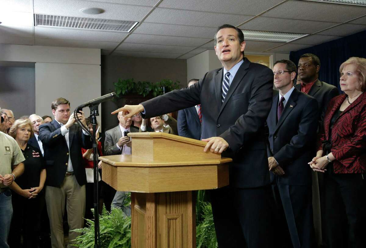 U.S. Sen. Ted Cruz (R-Texas) is surrounded by preachers as he addresses a crowd at a Houston church Thursday, Oct. 16, 2014. Cruz spoke about a legal dispute involving several pastors fighting subpoenas from Houston city attorneys demanding they turn over copies of any sermons they delivered that relate to Houston's equal rights ordinance championed by the city's gay mayor, Annise Parker. (AP Photo/Pat Sullivan)
