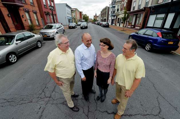 Members of city government from left;  Ed Tremblay, Director of Community Development;  Mayor George Primeau;  Melissa Cherubino, Building and Planning Director and Ralph Pascale, Grants Administrator stand on Remsen Street Wednesday morning Oct. 15, 2014 in Cohoes, N.Y.    (Skip Dickstein/Times Union) Photo: SKIP DICKSTEIN / 10029035A