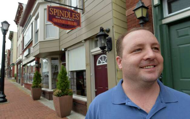 Don Russell, owner of Spindles Wine Bar stands outside of his establishment Wednesday morning Oct. 15, 2014 in Cohoes, N.Y.    (Skip Dickstein/Times Union) Photo: SKIP DICKSTEIN / 10029035A
