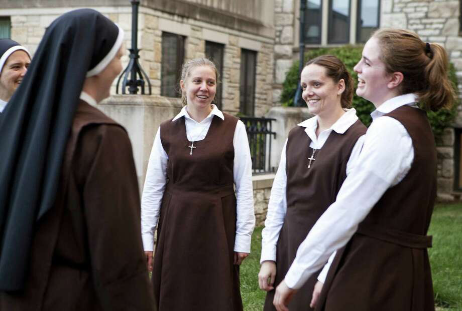 Nuns speak with postulants (from left) Marissa Mantey, Suzie Lott and Christina Heisler on the grounds of the Carmelite Sisters of the Divine Heart of Jesus convent near St. Louis, Mo. Photo: Ryan Gladstone / Religion News Service