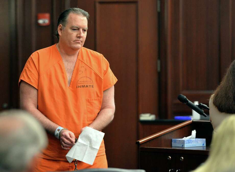 Michael Dunn returns to his seat after reading his statement, which included an apology to the Davis family, during his sentencing hearing Friday, Oct. 17, 2014 at the Duval County Courthouse in Jacksonville, Fla. Dunn, convicted of first-degree murder in a retrial in September for fatally shooting 17-year-old Jordan Davis in November 2012 in an argument over loud music outside a Florida convenience store was sentenced to life in prison without parole. (AP Photo/The Florida Times-Union, Bruce Lipsky, Pool) Photo: Bruce Lipsky, POOL / Pool The Florida Times-Union