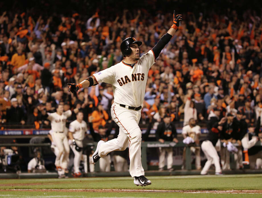 San Francisco Giants' Travis Ishikawa reacts after hitting a walk-off three-run home run in the ninth inning against the St. Louis Cardinals in Game 5 of baseball's NL Championship Series, Thursday, Oct. 16, 2014, in San Francisco. The Giants won 6-3, and advanced to the World Series. (AP Photo/St. Louis Post-Dispatch, Chris Lee) ORG XMIT: MOSTP345 Photo: Chris Lee / St. Louis Post-Dispatch