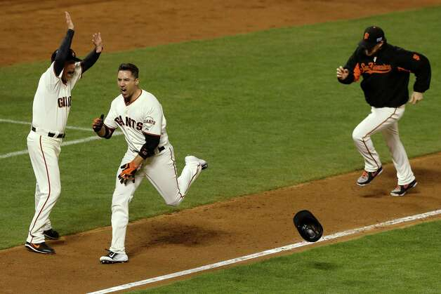 SAN FRANCISCO, CA - OCTOBER 16:  Travis Ishikawa #45 of the San Francisco Giants celebrates after he hits a three-run walk-off home run to defeat the St. Louis Cardinals 6-3 during Game Five of the National League Championship Series at AT&T Park on October 16, 2014 in San Francisco, California.  (Photo by Jason O. Watson/Getty Images) *** BESTPIX *** ORG XMIT: 517497343 Photo: Jason O. Watson / 2014 Getty Images