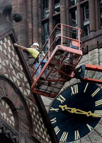 Monty Mongommery of the PCC Contracting Co. of Schenectady checks for loose parts on City Hall Friday morning Oct. 17, 2014 in Albany, N.Y. The Henry Hobson Richardson designed building was completed in 1883. It was added to the National Register of Historic Places in 1972.  (Skip Dickstein/Times Union) Photo: SKIP DICKSTEIN