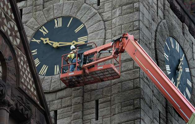 Monty Mongommery of the PCC Contracting Co. of Schenectady checks for loose parts on the clock at City Hall Friday morning Oct. 17, 2014 in Albany, N.Y. The Henry Hobson Richardson designed building was completed in 1883. It was added to the National Register of Historic Places in 1972.  (Skip Dickstein/Times Union) Photo: SKIP DICKSTEIN
