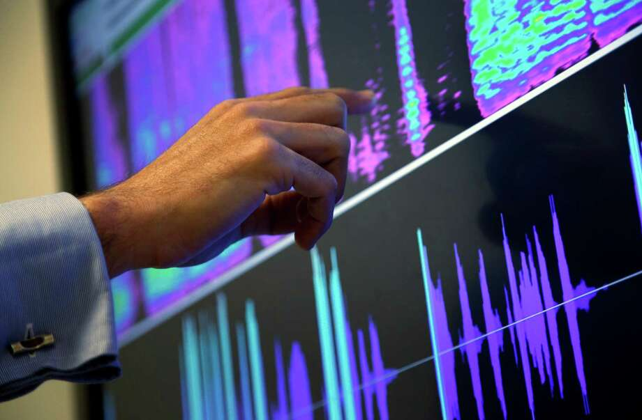 Benoit Fauve, a speech scientist with ValidSoft, points to a screen displaying the biometric features of a phone call during a demonstration in London. An AP survey found that more than 65 million people have had their voiceprints taken. Photo: Lefteris Pitarakis, STF / AP