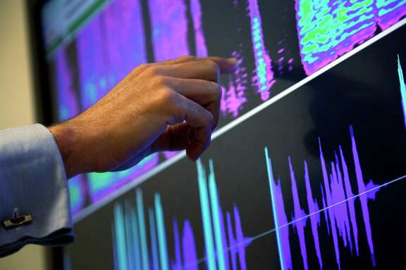 Benoit Fauve, a speech scientist with ValidSoft, points to a screen displaying the biometric features of a phone call during a demonstration in London. An AP survey found that more than 65 million people have had their voiceprints taken.