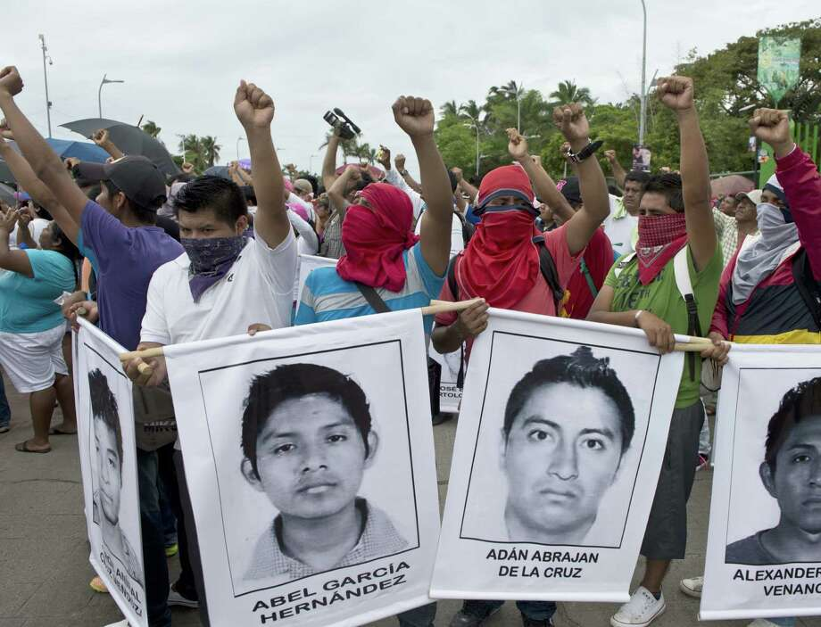 People march Acapulco, Mexico, demanding the safe return of students who disappeared from a rural teachers college. Photo: Ronaldo Schemidt / Getty Images / AFP