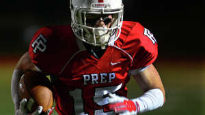 Fairfield Prep's John DelliSanti runs to the endzone to score a touchdown, during football action against Daniel Hand in Fairfield, Conn. on Friday October 17, 2014.