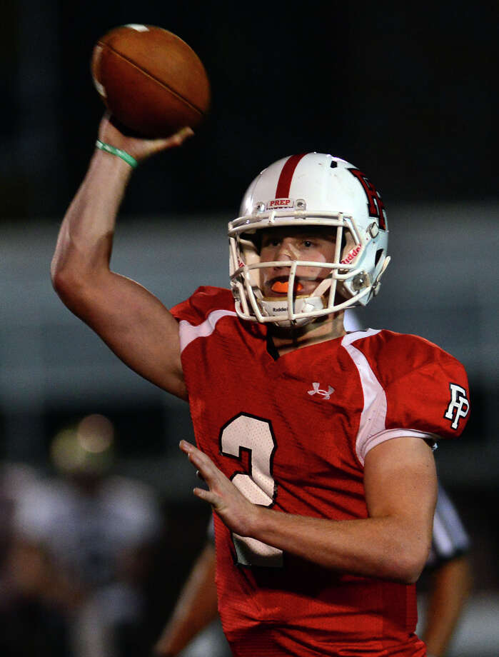 Fairfield Prep's Colton Smith throws a pass, during football action against Daniel Hand in Fairfield, Conn. on Friday October 17, 2014. Photo: Christian Abraham / Connecticut Post