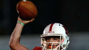 Fairfield Prep's Colton Smith throws a pass, during football action against Daniel Hand in Fairfield, Conn. on Friday October 17, 2014.
