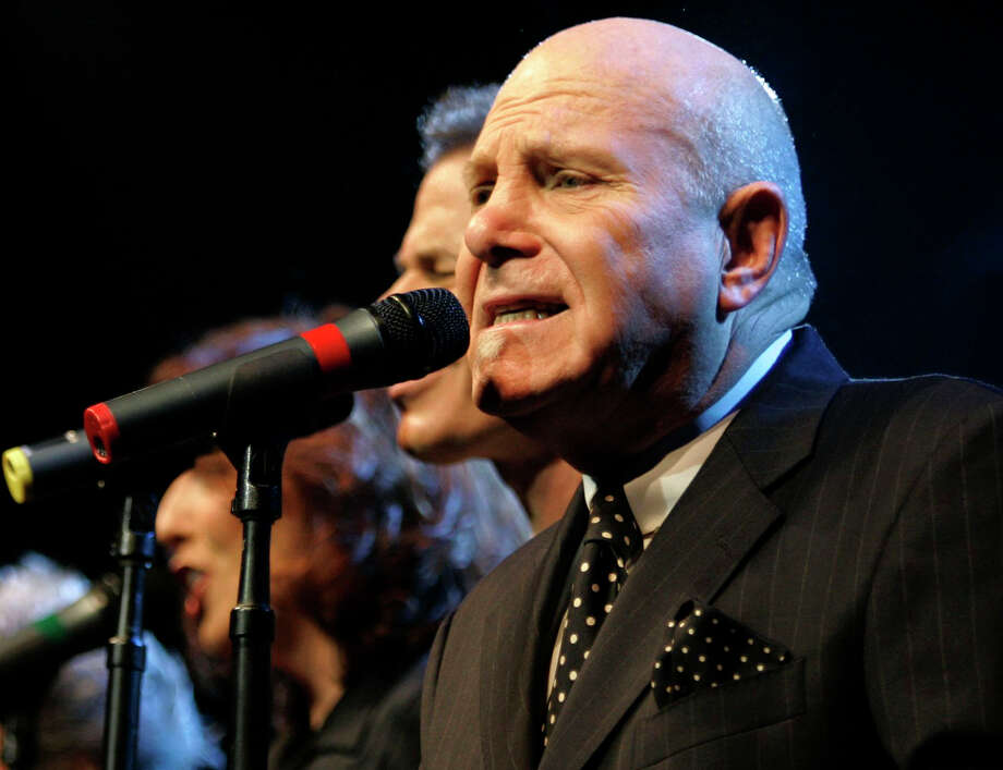 FILE - In this Nov. 8, 2006 file photo, Tim Hauser, right, performs with the other members of the U.S. vocal group The Manhattan Transfer at the Avo Session in Basel, Switzerland. Hauser, the founder and singer of the Grammy-winning vocal troupe The Manhattan Transfer, died Thursday from cardiac arrest, band representative JoAnn Geffen said Friday. He was 72. (AP Photo/Keystone, Georgios Kefalas, File) Photo: GEORGIOS KEFALAS, SUB / KEYSTONE