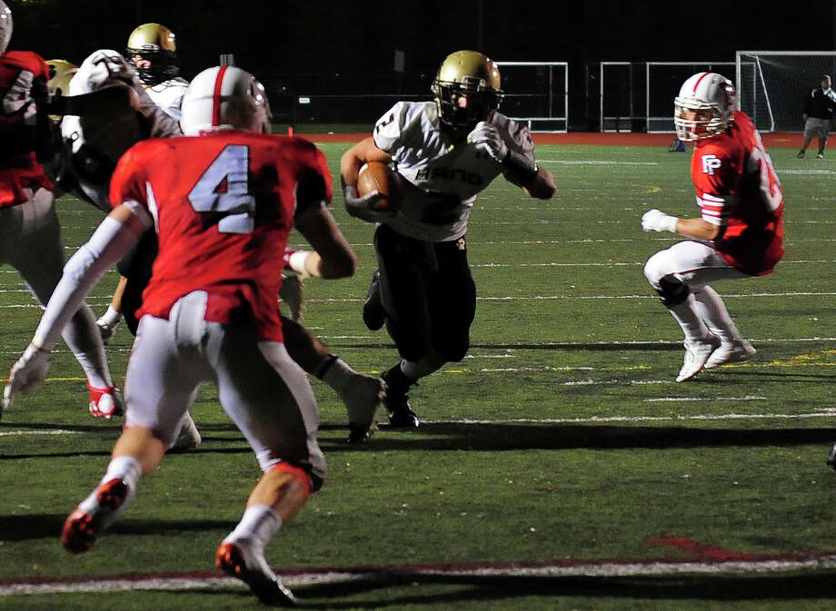 Daniel Hand's Tommy Wilson drives to the endzone for a touchdown, during football action against Fairfield Prep in Fairfield, Conn. on Friday October 17, 2014. Photo: Christian Abraham / Connecticut Post