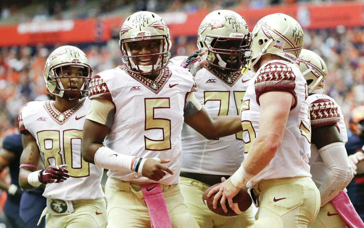 Florida State QB Jameis Winston (5), the reigning Heisman winner, will try to play through more controversy.